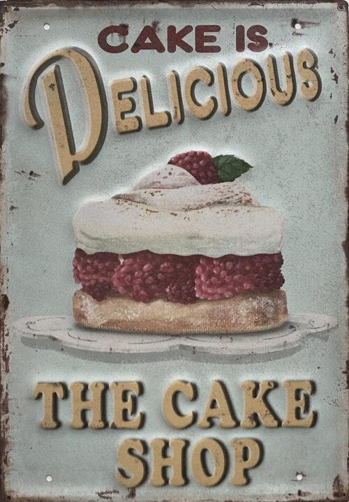 Retro metalen bord groot reliëf - Cake is delicious - the cake shop